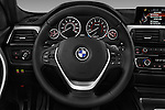 Car pictures of steering wheel view of a 2018 BMW 3-Series 330i-Sports-Wagon 5 Door Wagon Steering Wheel