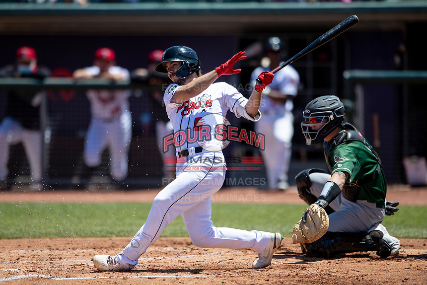 Lansing Lugnuts outfielder Austin Beck (6) follows through on his swing on May 30, 2021 against the Great Lakes Loons at Jackson Field in Lansing, Michigan. (Andrew Woolley/Four Seam Images)