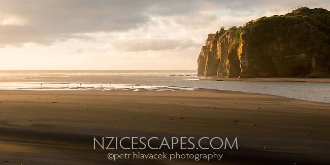 Sunset on coastline at Tongaporutu River estuary near New Plymouth, Taranaki Region, North Island, New Zealand, NZ