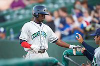 Cedar Rapids Kernels shortstop Nick Gordon (5) fist bumps teammates after scoring a run during a game against the South Bend Cubs on June 5, 2015 at Four Winds Field in South Bend, Indiana.  South Bend defeated Cedar Rapids 9-4.  (Mike Janes/Four Seam Images)