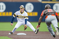 Michigan Wolverines shortstop Michael Brdar (9) waits for the catchers throw as Bowling Green Falcons baserunner Kory Brown (12) slides into second base on April 6, 2016 at Ray Fisher Stadium in Ann Arbor, Michigan. Michigan defeated Bowling Green 5-0. (Andrew Woolley/Four Seam Images)