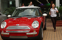 A red Mini-Cooper in front of the BMW car showroom in Guangzhou, China..