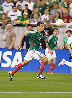 Mexico's Jared Borgetti races for the ball. USA 2, Mexico 0, at the University of Phoenix Stadium in Glendale, AZ on February 7, 2007.