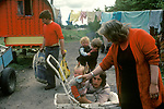 Irish Travellers   family grandmother,  mother , father, children  West Coast Southern Ireland Eire 1970s. Traditional Bow top wagon.
