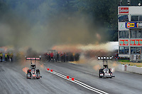 Aug. 6, 2011; Kent, WA, USA; NHRA top fuel dragster driver Larry Dixon (right) races alongside Terry McMillen during qualifying for the Northwest Nationals at Pacific Raceways. Mandatory Credit: Mark J. Rebilas-