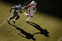 Sep 25, 2005; Seattle, WA, USA; Seattle Seahawks wide receiver #82 Darrell Jackson is defended by Arizona Cardinals cornerback #21 Antrel Rolle in the third quarter at Qwest Field. Mandatory Credit: Photo By Mark J. Rebilas