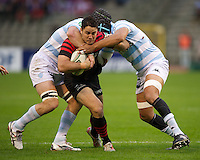 20121020 Copyright onEdition 2012©.Free for editorial use image, please credit: onEdition..Brad Barritt of Saracens is tackled during the Heineken Cup Round 2 match between Saracens and Racing Metro 92 at the King Baudouin Stadium, Brussels on Saturday 20th October 2012 (Photo by Rob Munro)..For press contacts contact: Sam Feasey at brandRapport on M: +44 (0)7717 757114 E: SFeasey@brand-rapport.com..If you require a higher resolution image or you have any other onEdition photographic enquiries, please contact onEdition on 0845 900 2 900 or email info@onEdition.com.This image is copyright the onEdition 2012©..This image has been supplied by onEdition and must be credited onEdition. The author is asserting his full Moral rights in relation to the publication of this image. Rights for onward transmission of any image or file is not granted or implied. Changing or deleting Copyright information is illegal as specified in the Copyright, Design and Patents Act 1988. If you are in any way unsure of your right to publish this image please contact onEdition on 0845 900 2 900 or email info@onEdition.com