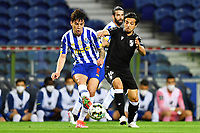 22nd April 2021; Dragao Stadium, Porto, Portugal; Portuguese Championship 2020/2021, FC Porto versus Vitoria de Guimaraes; Mateus Uribe of FC Porto passes ahead of the challenge from Rochinha of Vitoria de Guimaraes
