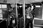 London transport 1970s bus ticket machine inside the bus. Commuters and shoppers getting onto a London Transport bus. Bus conductors giving out tickets have been stopped and ticket machines now take their place. 1970s UK