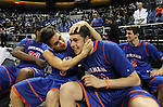 Bishop Gorman's Gio Guzman, left, and Ben Carter celebrate on the bench after the Gaiels defeated Hug High School 96-51 for the NIAA 4A State Basketball Championship at Lawlor Events Center, in Reno, Nev, on Friday, Feb. 24, 2012.  .Photo by Cathleen Allison