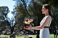 12th March 2020, Olympia, Greece;  An actress is seen with the Olypmic Flame during the flame lighting ceremony for Tokyo 2020 Olympic Games