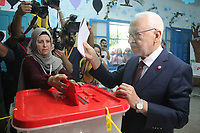 Ennahdha Party leader Rached Ghannouchi casts his ballot at a polling station in the capital Tunis on October 6, 2019, during the third round of legislative elections since the North African country's 2011 revolution.