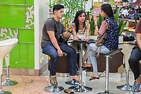 Yogyakarta, Java, Indonesia.  Ambarrukmo Shopping Mall.  Young Couple and Friend.