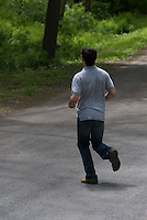 Man running on country road