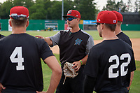 Batavia Muckdogs defensive coach Nathan Mikolas discusses strategy with the outfielders during practice on June 12, 2019 at Dwyer Stadium in Batavia, New York.  (Mike Janes/Four Seam Images)