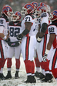 December 16th, 2007:  Buffalo Bills offensive lineman Jason Peters (71) takes a break during a timeout in the huddle with teammates Trent Edwards (5), Josh Reed (82), Derrick Dockery (66), and Fred Jackson (22) at Cleveland Browns Stadium in Cleveland, Ohio.  The Browns shutout the Bills 8-0 to inch closer to clinching a playoff spot.  Photo Copyright Mike Janes Photography.