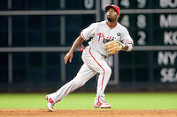 Philadelphia Phillies shortstop Jimmy Rollins #11 on defense during the Major League Baseball game against the Houston Astros at Minute Maid Park in Houston, Texas on September 13, 2011. Houston defeated Philadelphia 5-2.  (Andrew Woolley/Four Seam Images)