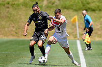 Regont Murati of Waitakere United competes for the ball with Rory McKeown of Team Wellington during the ISPS Handa Men's Premiership - Team Wellington v Waitakere Utd at David Farrington Park,Wellington on Saturday 30 January 2021.<br /> Copyright photo: Masanori Udagawa /  www.photosport.nz