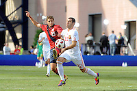 Robbie Rogers (19) of the United States challenges Alvaro Negredo (22) of Spain for teh ball. The men's national team of Spain (ESP) defeated the United States (USA) 4-0 during a International friendly at Gillette Stadium in Foxborough, MA, on June 04, 2011.