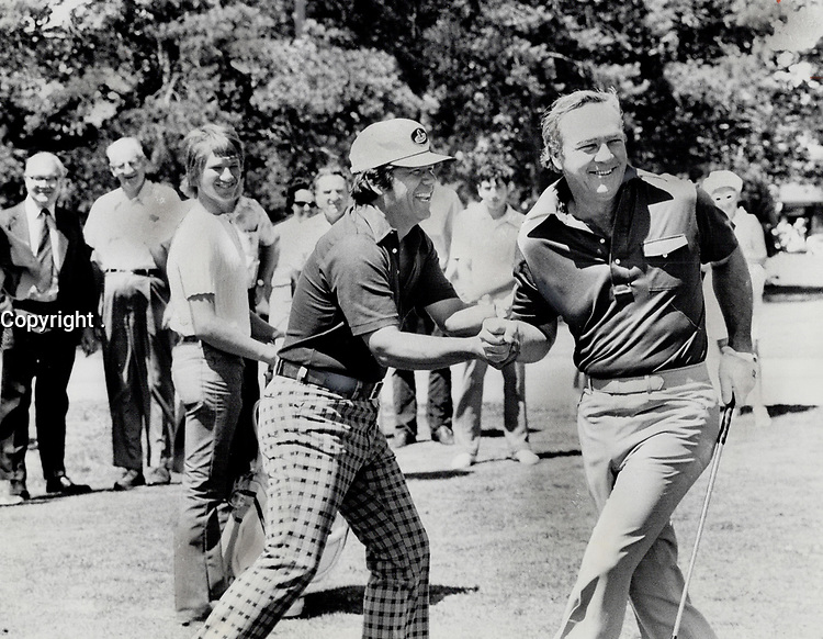 1973 FILE PHOTO - ARCHIVES -<br /> <br /> 1973 FILE -<br /> <br />  Lee Trevino, left, and Arnold Palmer, enjoyed a little play yesterday at Mississaugua Golf Club during an exhibition round.<br /> <br /> PHOTO : <br /> Bull, Ron<br /> <br /> PHOTO : Ron BULL - Toronto Star Archives - AQP
