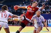 BELGRADE, SERBIA - DECEMBER 16: Suzana Lazovic of Montenegro (C) jump to scores past Linn Gosse (L) and Ida Alstad (R) of Norway during the Women's European Handball Championship 2012 gold medal match between Norway and Montenegro at Arena Hall on December 16, 2012 in Belgrade, Serbia. (Photo by Srdjan Stevanovic/Getty Images)
