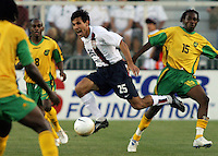 Pablo Mastroeni yells to a teammate as he tries to thread the ball through three Jamaican defenders. The USA tied Jamaica 1-1 at SAS Soccer Park in Cary, N.C. on April 11, 2006.