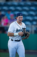 Everett AquaSox designated hitter Cal Raleigh (33) jogs off the field after warming up the pitcher between innings of a Northwest League game against the Tri-City Dust Devils at Everett Memorial Stadium on September 3, 2018 in Everett, Washington. The Everett AquaSox defeated the Tri-City Dust Devils by a score of 8-3. (Zachary Lucy/Four Seam Images)