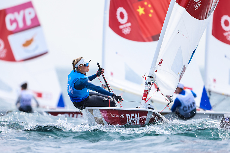 Consistent sailing from Dane Anne Marie Rindom gives her a consistent score of 6, 5, 3, 4, 4 to lead at th half way point of the regatta