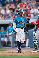 Grand Rapids Dam Breakers Wenceel Perez (23) bats during a game against the Fort Wayne TinCaps on August 21, 2021 at LMCU Ballpark in Comstock Park, Michigan.  The West Michigan Whitecaps rebranded for the day as the Grand Rapids Dam Breakers to bring awareness to the Grand River Restoration Project. (Mike Janes/Four Seam Images)