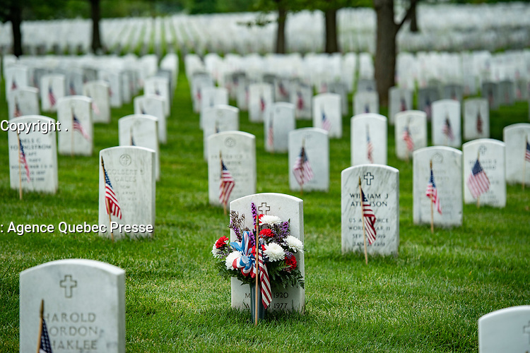 Flags decorate gravesites in preparation for Memorial Day ,in Section 60 of Arlington National Cemetery, Arlington, Virginia, May 24, 2020. (U.S. Army photo by Elizabeth Fraser / Arlington National Cemetery / released)