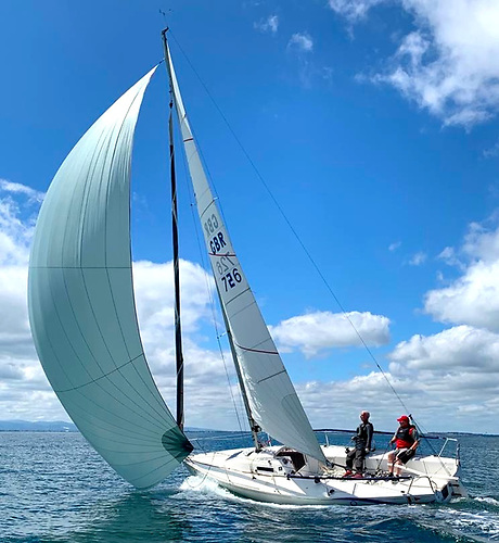 Summer perfection – Sutton DC Commodore Ian McCormack and Nobby Reilly on helm, racing a J/80 in the Aqua Two-Hander Round Lambay at Howth.  Photo Lynn Reilly