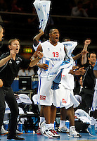French national basketball team head coah Collet Vincent and Diaw Boris (13) reacts during semifinal basketball game between France and Russia in Kaunas, Lithuania, Eurobasket 2011, Friday, September 16, 2011. (photo: Pedja Milosavljevic)