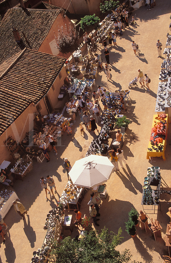 France. Provence.  Market at Roussillon, Vaucluse, of pottery from the local red earth, a particularly suitable material for fine pottery