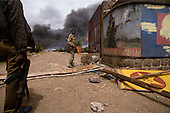 Addis Ababa, Ethiopia<br /> June 4,1991<br /> <br /> An Ethiopian People's Revolutionary Democratic Front (EPRDF), soldiers patrols an exploding ammunition depot set alight by former government supporters.<br /> <br /> In late May 1991 the long civil war in Ethiopia came to a climax when the alliance of four rebel groups, the EPRDF, toppled the authoritarian government of Mengistu Haile-Mariam and took control of Addis Ababa and the nation. The governing regime declared a cease-fire and fled. <br /> <br /> In July 1991 the 24 different groups met in the capital and established a multi-party provisional government headed by Meles Zenawi, the Tigray Rebel Leader, to lead the country to its first free elections within two years.