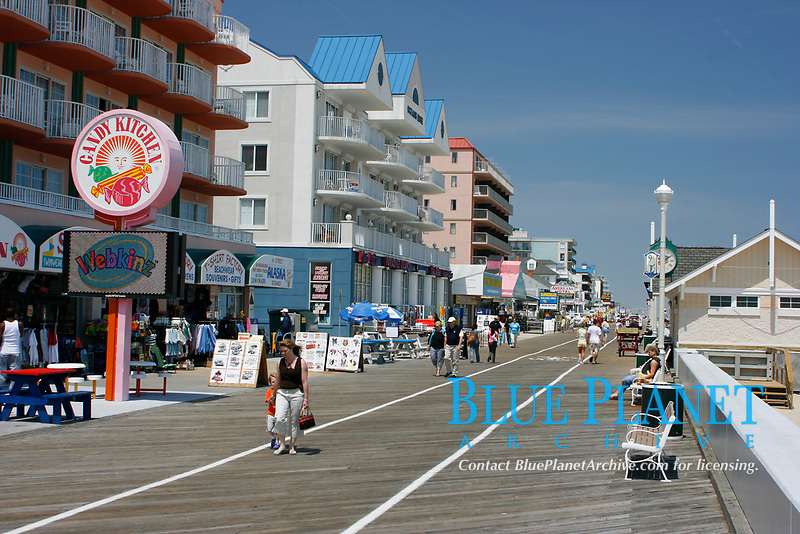 Tourists enjoy a day out walking past the many hotels and attractions lining the boardwalk located along the beach at Ocean City, Maryland. Atlantic Ocean
