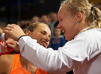 Februari 08, 2015, Apeldoorn, Omnisport, Fed Cup, Netherlands-Slovakia, Arantxa Rus (NED)  jubilates her victory Holland wins 3-1 and falls into the arms of Kiki Bertens<br /> Photo: Tennisimages/Henk Koster