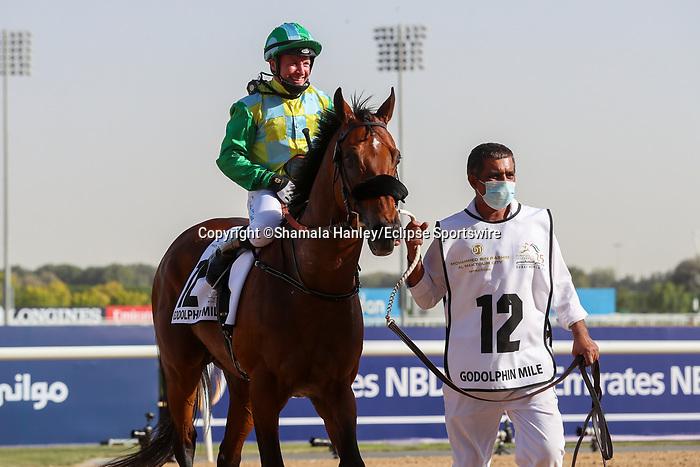 March 27, 2021: SECRET AMBITION #12 ridden by Tadhg O'Shea wins The Group 2 Godolphin Mile for Satish Seemar on Dubai World Cup Day, Meydan Racecourse, Dubai, UAE. Shamela Hanley/Eclipse Sportswire/CSM