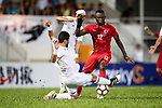 Tareq Khattab of Jordan (L) fights for the ball with Alexander Oluwatayo Akande of Hong Kong (R) during the International Friendly match between Hong Kong and Jordan at Mongkok Stadium on June 7, 2017 in Hong Kong, China. Photo by Marcio Rodrigo Machado / Power Sport Images