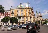 Traffic in city center with beautiful architecture, Lviv, Ukraine