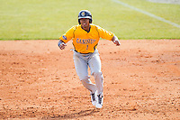 Jose Torralba (1) of the Canisius Golden Griffins takes his lead off of first base against the Charlotte 49ers at Hayes Stadium on February 23, 2014 in Charlotte, North Carolina.  The Golden Griffins defeated the 49ers 10-1.  (Brian Westerholt/Four Seam Images)