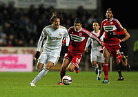 Saturday, 12 December 2012<br /> Pictured L-R: Michu of Swansea followed by mmanuel Ledesma of Middlesbrough<br /> Re: Capital One Cup, fifth round, Swansea City FC v Middlesbrough at the Liberty Stadium, south Wales.