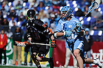 Face-Off Classic:  Midfielder Jimmy Dunster #20 of the North Carolina Tar Heels drives toward the cage during the Princeton v North Carolina mens lacrosse game at M&T Bank Stadium on March 10, 2012 in Baltimore, Maryland. (Ryan Lasek/Eclipse Sportswire)