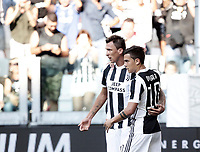 Calcio, Serie A: Torino, Allianz Stadium, 19 agosto 2017. <br /> Juventus' Mario Mandzukic (l) celebrates after scoring with his teammate Paulo Dybala (r) during the Italian Serie A football match between Juventus and Cagliari at Torino's Allianz Stadium, August 19, 2017.<br /> UPDATE IMAGES PRESS/Isabella Bonotto