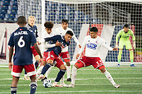 FOXBOROUGH, MA - OCTOBER 16: Justin Che #46 of North Texas SC and Damian Rivera #72 of New England Revolution II battle for the ball during a game between North Texas SC and New England Revolution II at Gillette Stadium on October 16, 2020 in Foxborough, Massachusetts.