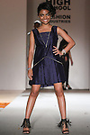 Model walks runway in an outfit by graduating student, during the High School of Fashion Industries 2015 fashion show on June 3, 2015.