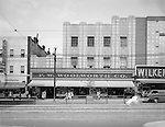 Pittsburgh PA: View of Businesses along Penn Avenue in the East Liberty section of Pittsburgh.  Stores included: Wilken's Jewelry Store, FW Woolworth, and Anthons Bakery and Restaurant.