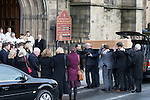 © Joel Goodman - 07973 332324 . 16/01/2014 . Salford , UK . The coffin is carried in to the cathedral . The funeral of Labour MP Paul Goggins at Salford Cathedral today (Thursday 16th January 2014) . The MP for Wythenshawe and Sale East died aged 60 on 7th January 2014 after collapsing whilst out running on 30th December 2013 . Photo credit : Joel Goodman