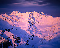 Aerial view of Mount Olympus' south aspect taken during a winter sunset, Olympic National Park, Washington State.