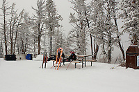 Skiers rest at the top of the mountain at Showdown Ski Area on King's Hill in the Little Belt Mountains near Neihart, Montana, USA.