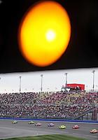 Feb 22, 2009; Fontana, CA, USA; NASCAR Sprint Cup Series drivers drive under the caution for rain during the Auto Club 500 at Auto Club Speedway. Mandatory Credit: Mark J. Rebilas-